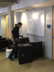 Contractors installing new WIFI Routers in the Ryerson Student Centre